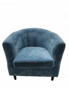 Sillón azul con tapizado...